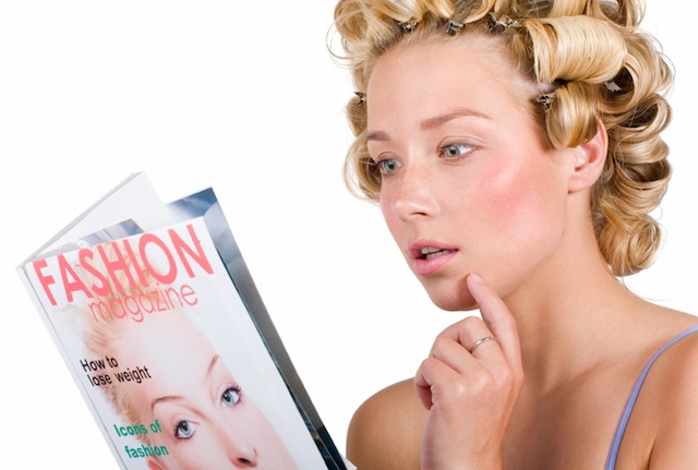 Woman in hair curlers reading fashion magazine. Magazine cover is fictional and has my image on it.